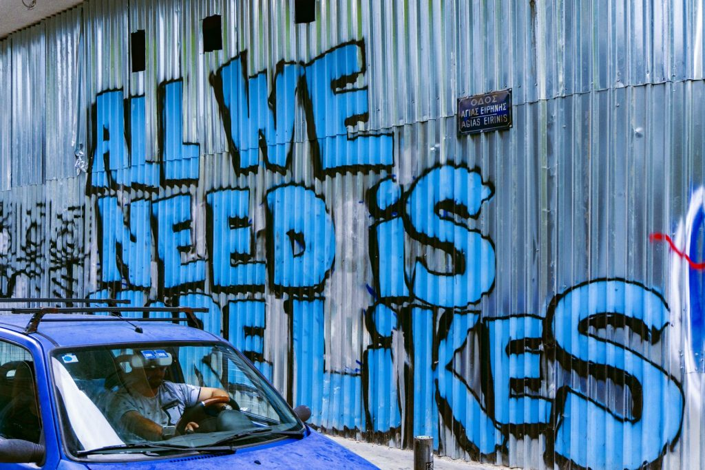 'All we need is likes' graffiti
