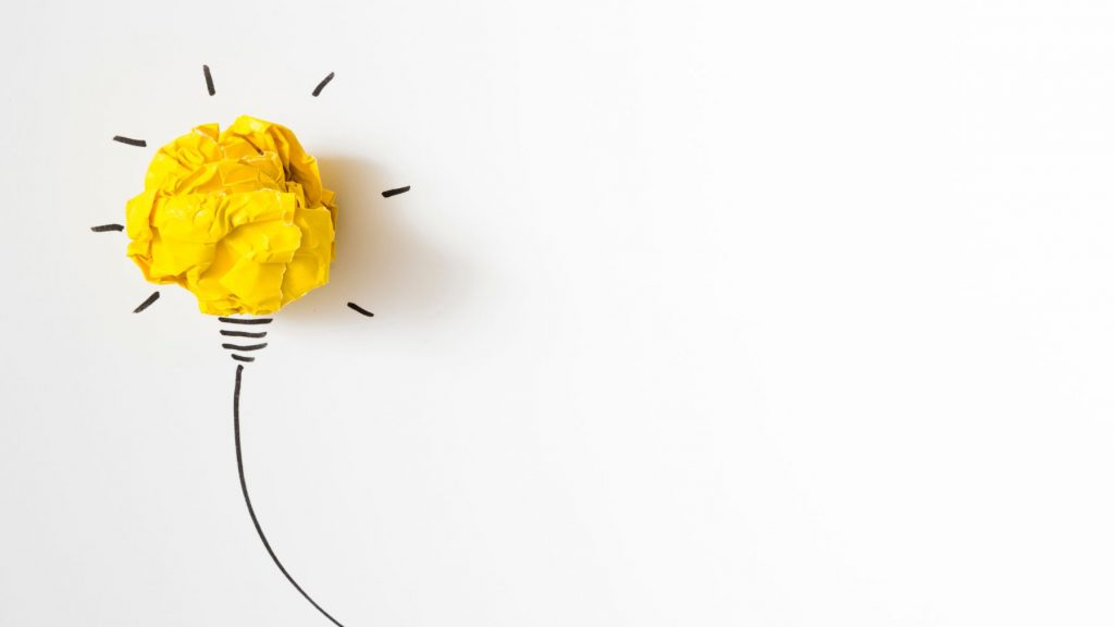 illuminated-crumpled-yellow-paper-light-bulb-idea-white-background