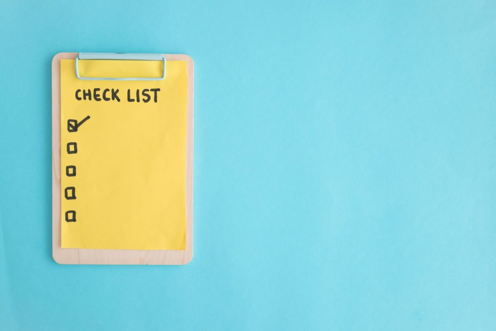 check-list-paper-wooden-clipboard-blue-background