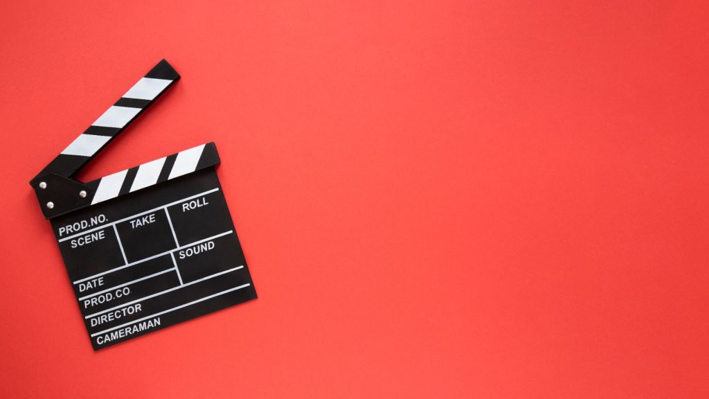 movie-clapper-red-background