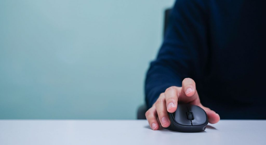 man-hand-using-mouse-cursor-scrolling-web-page-working-computer